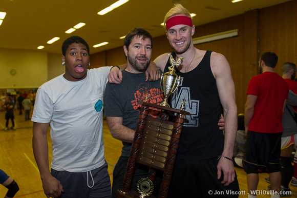 Jake Mason, flanked by two of last year's champs, holds the coveted golden cock trophy.