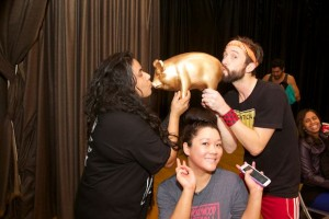"""Dickelodeon kissing the coveted """"bottom pig."""" (Photo by Matt Baume)"""