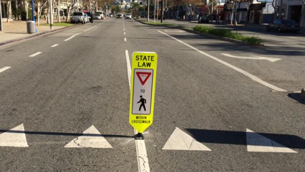 Pedestrian crosswalk warning sign on Santa Monica Boulevard at Ramage