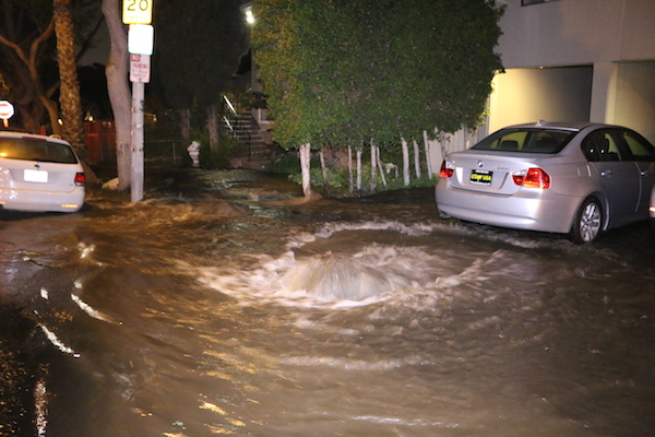 A water main break flooded North Formosa Avenue this morning (Photo by Jim Garrecht).