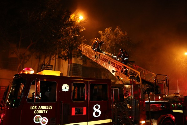 Firefighters at 9080 Santa Monica Blvd. on May 21. (Photo by Jim Garrecht)