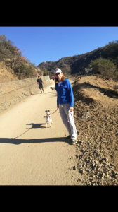 An apparently un-disabled Heidi Shink on a hike with her dog.