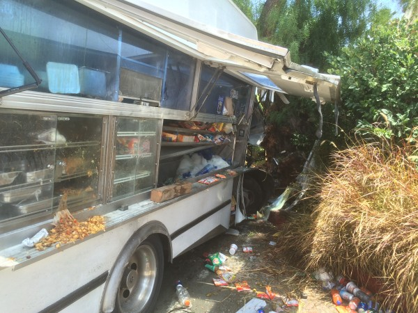 Four people were injured today in the crash of a food truck on North Doheny Drive (Photo by Jim Garrecht)