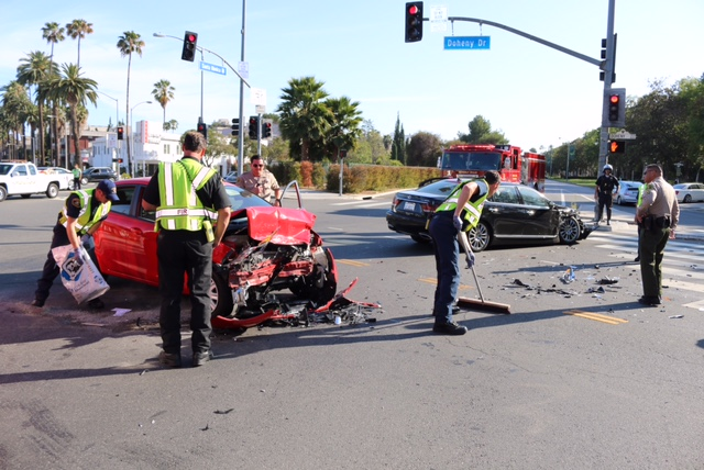 Crash around 5:30 p.m. today at the intersection of Santa Monica Boulevard and Doheny in West Hollywood. (Photo by Jim Garrecht)