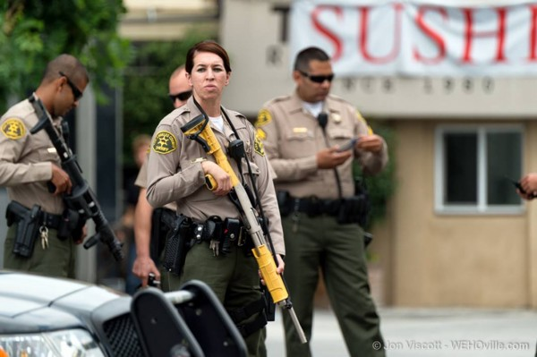 Sheriff's deputies armed with stun guns shut down Sunset Boulevard while fans line up to get wristbands for the Future concert (Photo by Jon  Viscott).