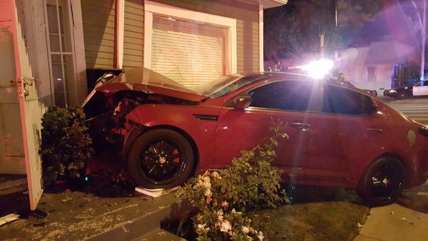 Car crashed into front of house at 7414 Fountain Ave.