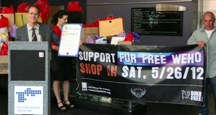 """Council member John D'Amico speaks at the city's Fur Free Weho Shop In press conference May 24, 2013. In a 1990 resolution, West Hollywood declared itself to be a """"cruelty-free zone"""" for animals. A ban on fur was adopted in in 2011, took effect in 2013, survived a court challenge in 2014 and was amended in 2015. (City of West Hollywood photo by Brett White)"""