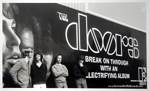 The Doors pose in front of the Sunset Strip billboard promoting their debut album in 1967. (Photo courtesy of Clear Channel Outdoor Archives)/