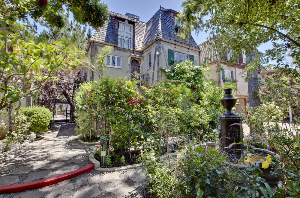 A view of The Charlie's lushly landscaped courtyard. (Photo credit: Yelp.com)