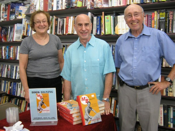 "Dr. Kenneth Krauss (middle), author of ""Male Beauty,"" with Karen and Barry Mason, owners of Circus of Books in West Hollywood."