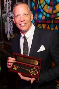 The Abbey's David Cooley holding the Key to the City