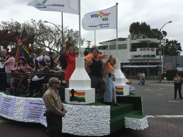 From left, City Councilmembers Lindsey Horvath (in red) and John Duran (in black tank top) and Mayor Lauren Meister (in orange blouse) on WeHo Commission float in LA Pride parade.