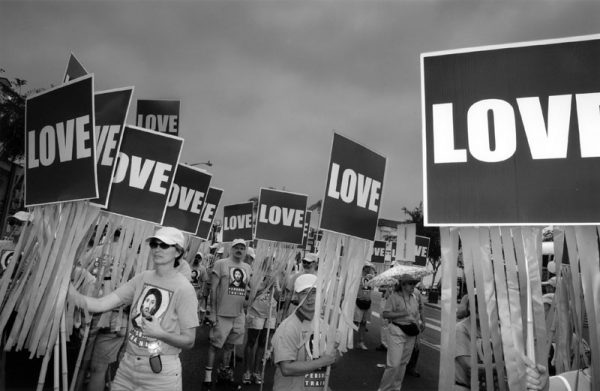 Gay Episcopalians quietly carrying love signs at the 34th Annual Gay, Lesbian, Transgender and Bisexual Pride Parade in 2004. (Photo by Douglas McCulloh, L.A. Neighborhoods Project, Los Angeles Public Library Photo Collection)