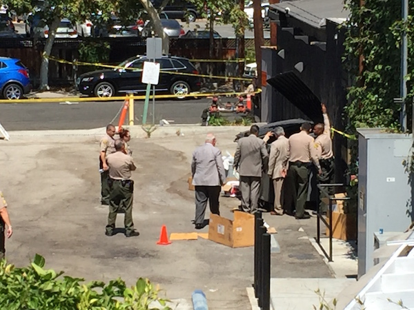 Sheriff's investigators around the dumpster behind Dominick's where a woman's body was found. (Photo courtesy of Aaron Micu).