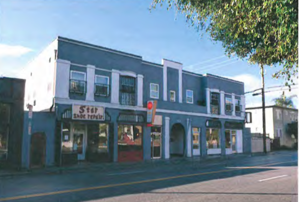 7960 Fountain Ave. is a two-story commercial building in the 20th Century Commercial style with Spanish Colonial Revival influences built in 1927 by Charles H. Clark. The four storefronts at 7960, 62, 66, and 68 have housed various businesses such as a beauty parlor , a dressmaker, a milliner and a dry cleaner. Star Shoe Repair has occupied the storefront at 7960 Fountain since at least 1973. Fifteen apartments occupy the remainder of the first floor and all of the second floor.