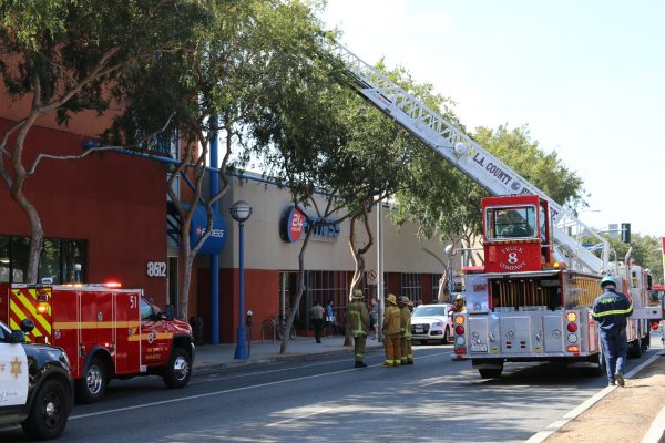 Firefighters responding to an air conditioner fire at WeHo's 24 Hour Fitness. (Photo by Jim Garrecht / ANG News)